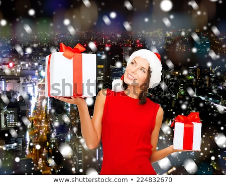 Stock photo: cheerful santa helper girl with big gift box