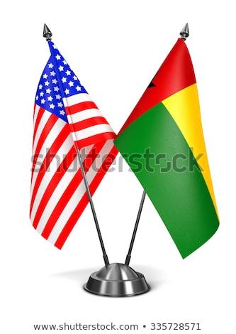 USA and Guinea - Miniature Flags. Stock photo © tashatuvango
