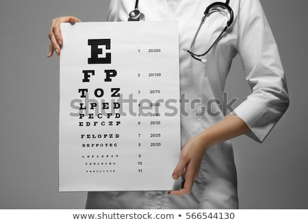 Foto stock: Young Woman Ophthalmologist With Eye Chart