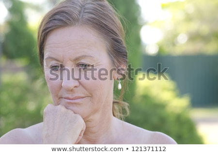 Concerned worried mature woman outdoor Stock photo © roboriginal