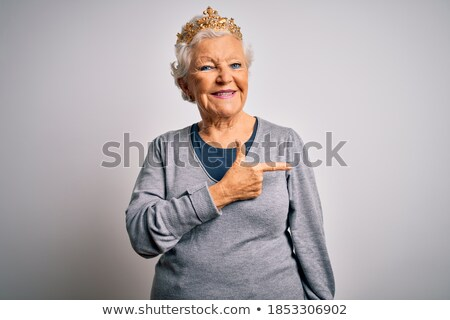 woman in crown with fashionable hair over grey stock photo © dolgachov