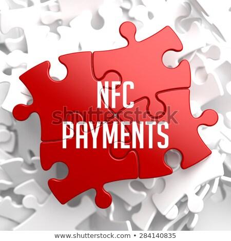 NFC on Red Puzzle. Stock photo © tashatuvango