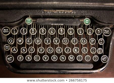 retro toned vintage typewriter keys stock photo © stevanovicigor