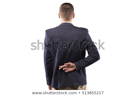 Businessman with fingers crossed behind his back Stock photo © Paha_L
