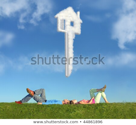 lying couple on grass and dream house key collage stock photo © paha_l