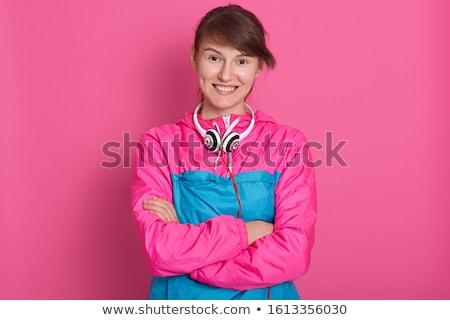 Brunette fitness vrouw gevouwen armen studio Stockfoto © RuslanOmega