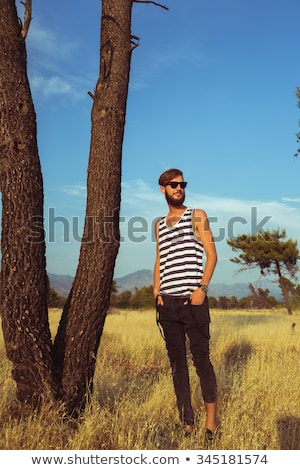 Portrait of a young stylish handsome man in the savannah Stock photo © vlad_star
