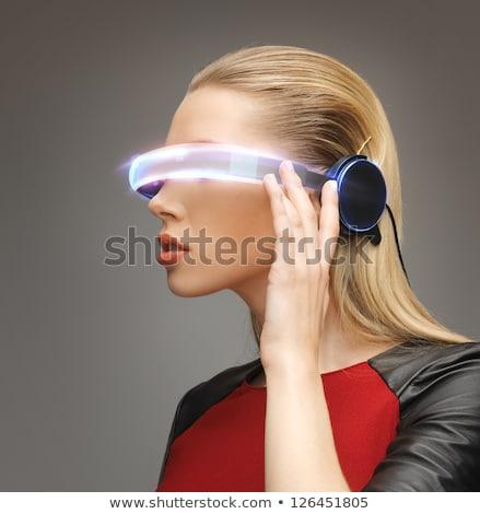 Zdjęcia stock: Pretty Woman Looking With Futuristic High Tech Glasses
