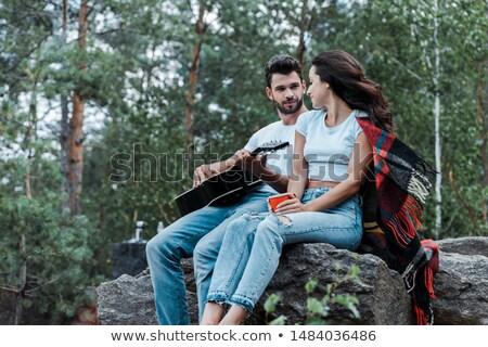 Jeune homme guitare acoustique photo jeunes séduisant Photo stock © sumners