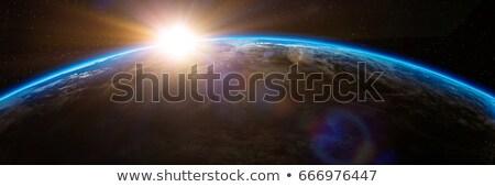 Sunrise pianeti spazio view tramonto mare Foto d'archivio © sdecoret