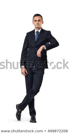 Fiatal üzletember pózol lábak keresztbe egészalakos kép Stock fotó © feedough