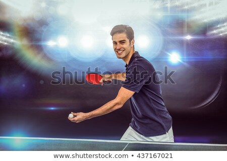 Foto stock: Composite Image Of Portrait Of Happy Male Athlete Holding A Ball