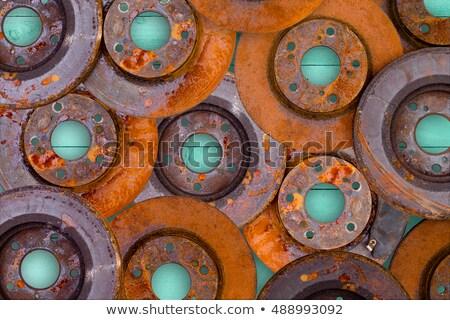 conceptual image of overlaid rusty brake rotors stock photo © ozgur