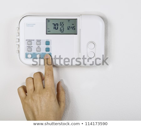 utility bill with heating thermostat on wall stock photo © tab62