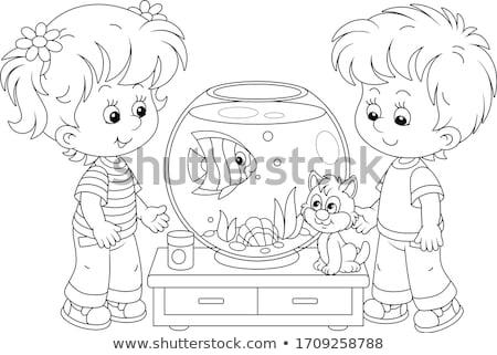 Kid playing with fishes in aquarium Stock photo © zurijeta