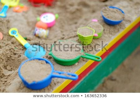 Yellow and pink sandbox toys Stock photo © homydesign