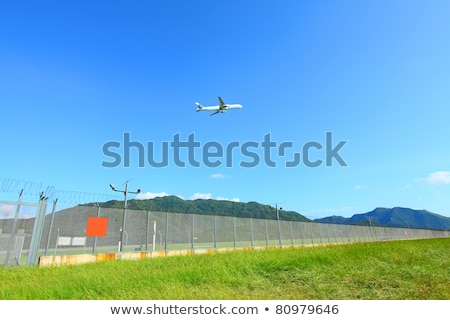 Foto stock: Green Landscape With Aircraft