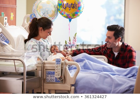 Woman with new born in maternity ward. Stock photo © RAStudio