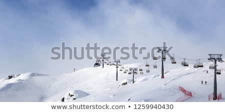 ski slope with snowmaking on winter resort stock photo © bsani