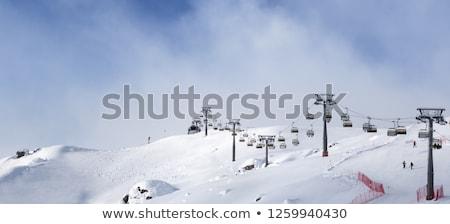 Ski slope with snowmaking on winter resort Stock photo © BSANI