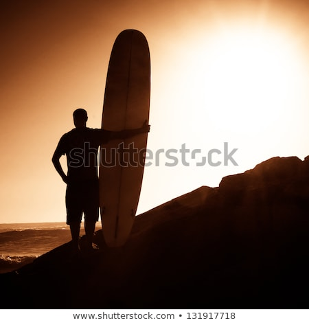 Long boarder watching the waves Stock photo © homydesign