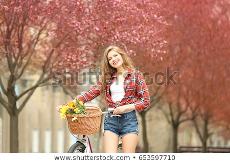 Beautiful woman with a vintage bicycle in a city park  stock photo © Yatsenko