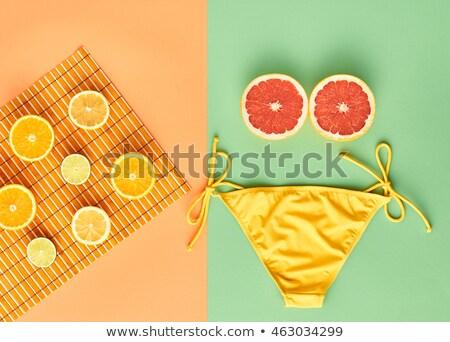 mujer · pomelo · frutas · rojo · atención - foto stock © fisher