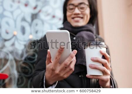portre · konsantre · genç · Asya · adam · cep · telefonu - stok fotoğraf © deandrobot