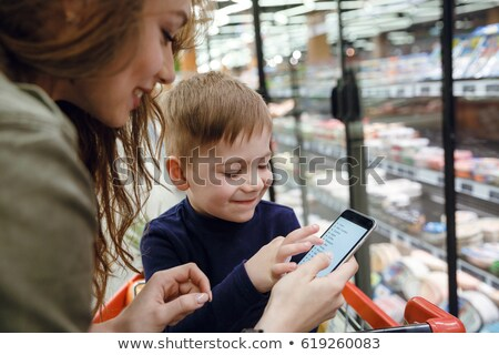 Mother and son browsing shopping list Stock photo © deandrobot