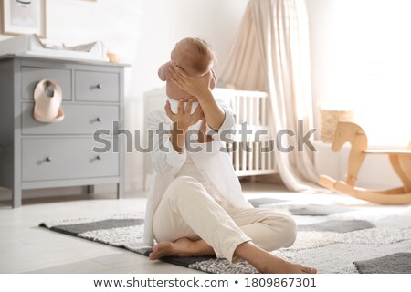 Back view of baby girl sitting on floor with plaid Stock photo © deandrobot