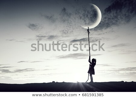pulling moon Stock photo © psychoshadow