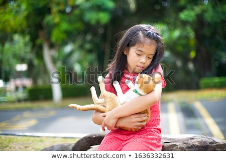 Beautiful girl with oriental siam cat Stock photo © svetography