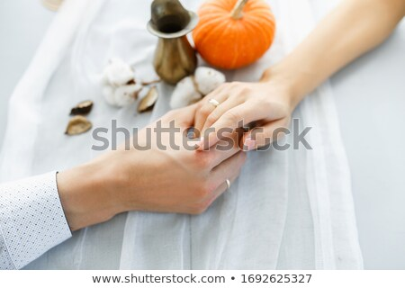 hand holding pumpkin Stock photo © LightFieldStudios