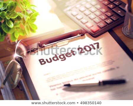 Clipboard with 2017 Economic Forecast. 3D. Stock photo © tashatuvango