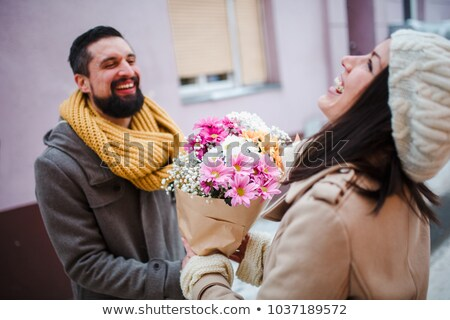 Man offering flowers to a woman Stock photo © IS2