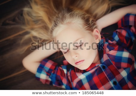 fashion blonde girl lies on the floor eyes closed Stock photo © dmitriisimakov