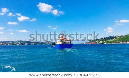 грузовое · судно · Восход · морем · лет · силуэта · волны - Сток-фото © givaga