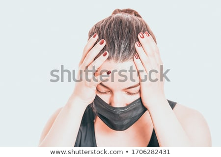 A woman in a medical mask Stock photo © shyshka