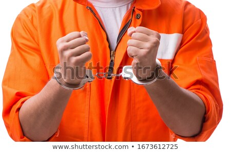 Handcuffed handsome businessman isolated on white background Stock photo © Elnur