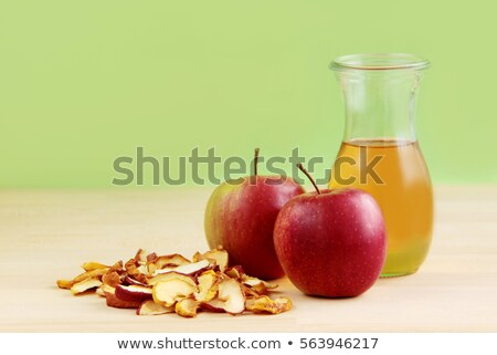 Bottle of fresh organic apple juice with healthy green apples in box on wooden background Stock photo © DenisMArt