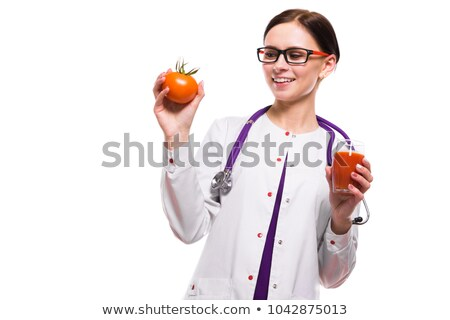 Female nutritionist hold tomato in section and glass of juice in her hands on white background Stock photo © Traimak