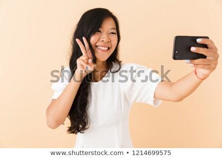 mooie · asian · vrouw · poseren · geïsoleerd · beige - stockfoto © deandrobot