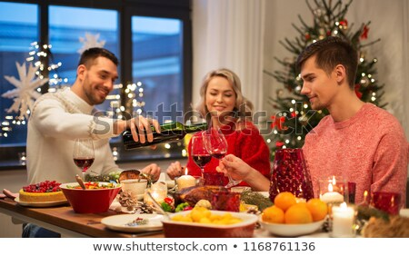 alcoholic pouring red wine to glass at home Stock photo © dolgachov