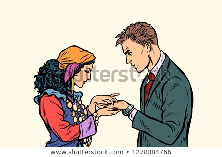 a Gypsy telling fortunes by hand to businessman Stock photo © studiostoks