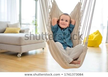 Chłopca gry huśtawka ilustracja niebo tle Zdjęcia stock © bluering