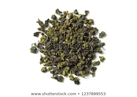Dry oolong tea leaves on white background Stock photo © eddows_arunothai