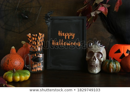 blank chalkboard and halloween decorations stock photo © dolgachov