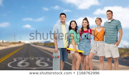Stock photo: friends with skateboards over us route 66