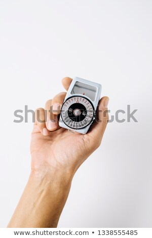 man with an analog light meter in his hand Stock photo © nito