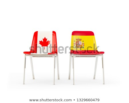 two chairs with flags of canada and spain stock photo © mikhailmishchenko